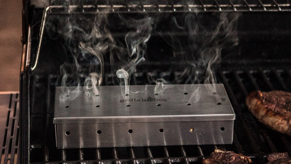 Purchasing a gas grill brings hope that you'll finally enjoy home-made grilled meals. However, you should know how to use a smoker box on a gas grill to give your meals that fine smoke taste!