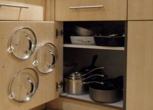 how to organize pots and pans using a cabinet organizer